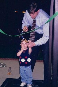 Gary Greene with son, Joey, cutting ribbon to first Greene Resources office