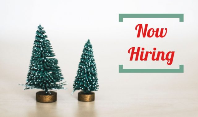 "Two seasonal holiday trees with the words ""now hiring"""