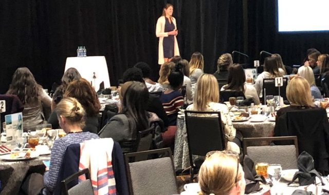 Presenter on stage at the Women's Luncheon