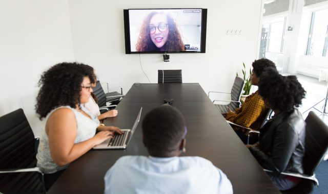 virtual meeting in a conference room. woman on screen