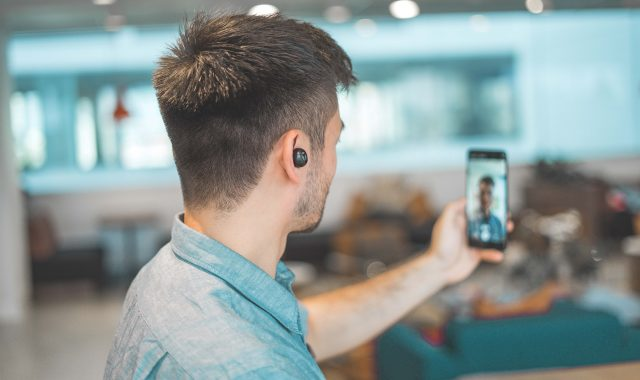 virtual meeting attendee man on a phone video chatting