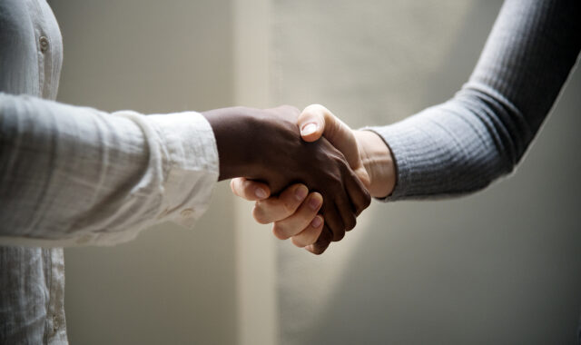 Toe people shaking hands after an interview